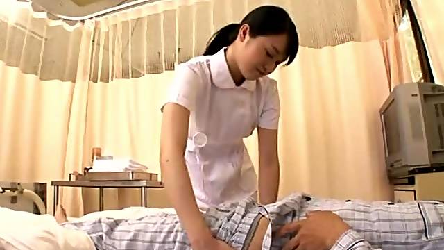 Pretty Japanese nurse gives nice handjob to a patient