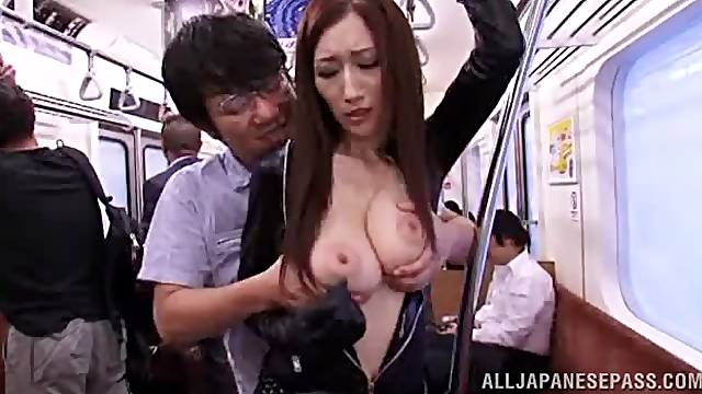 A gorgeous Asian mom has her lovely hooters played with