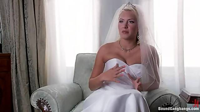 Sexy blonde enjoys a gangbang on her wedding night