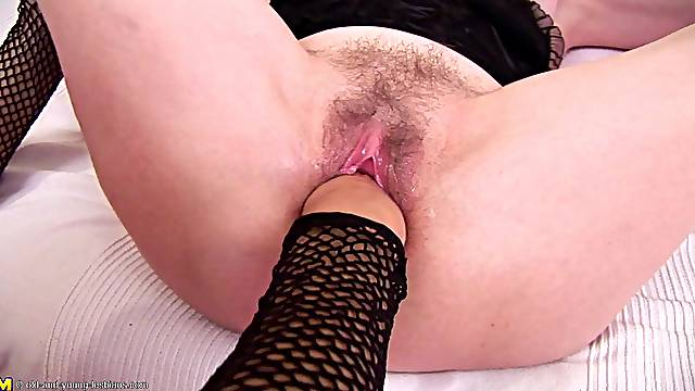 Redhead Irina copping with pussy fisting in mature porn