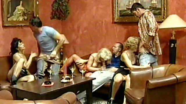 Blonde woman enjoys being fucked during an orgy session