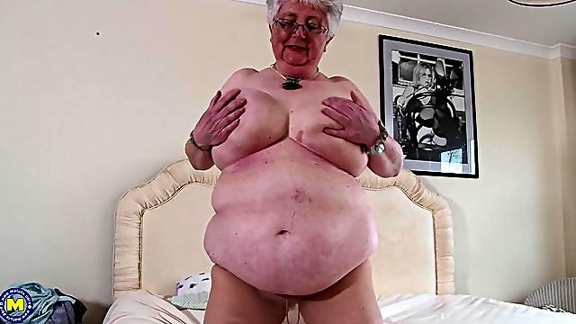 Mature short haired amateur granny Caroline V. fingers her pussy