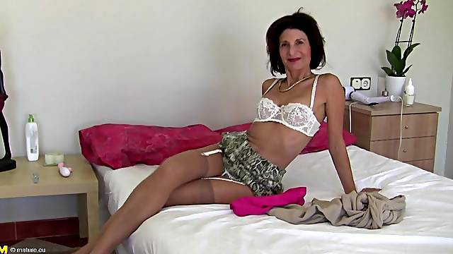 Skinny brunette mature MILF Emanuelle pounds her pussy with a dildo