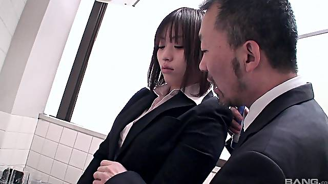 Brunette Asian in the bathroom gets groped by a businessman