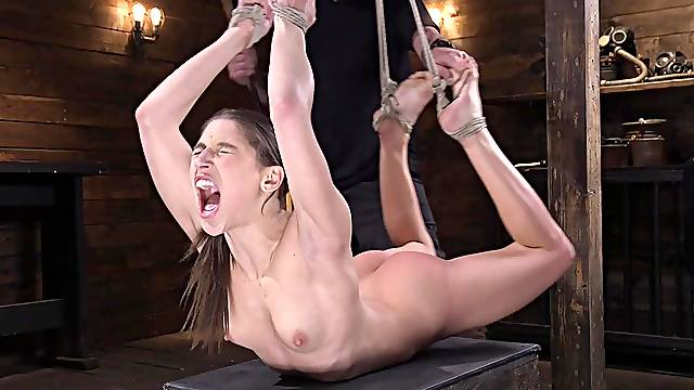 Abella Danger is tied in the basement waiting to be pleased with sex toys