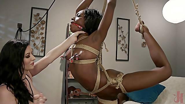 Pale dark haired mistress Cherry Torn abuses ebony babe Noemie Bilas