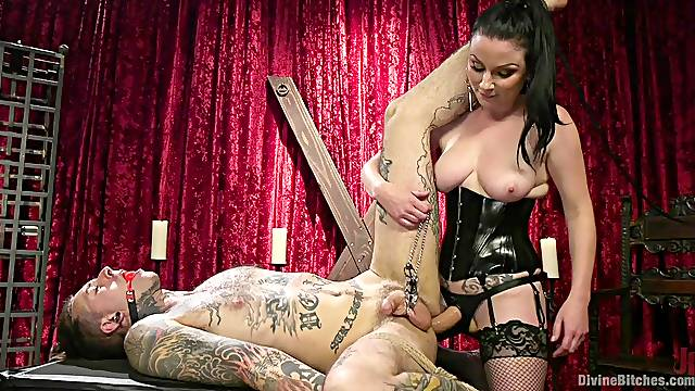 Strict femdom mistress Veruca James pegs her slave in his cage