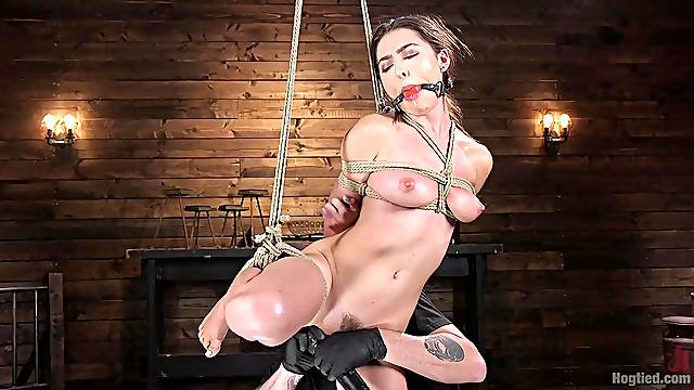 Tied Melissa Moore gets her pussy pleased in the stranger's basement