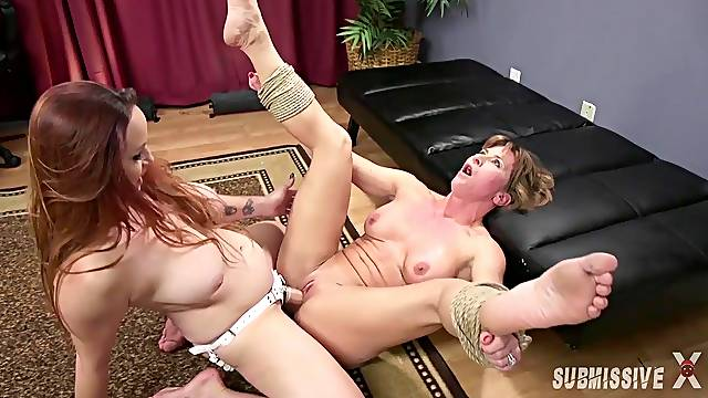 After a long day lesbian Bella Rossi is ready for a strapon fuck