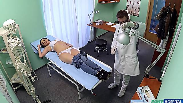 Daphne Klyde spreads her legs so a doctor can inspect her pussy