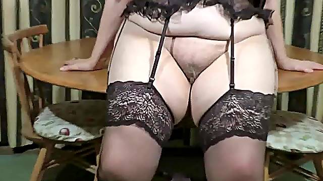 Striptease grandma in stockings