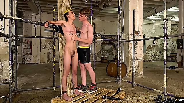 Young lovers drop their clothes to have dirty gay sex in the BDSM room