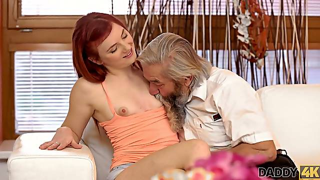 Lovely redhead has crazy sex with old man while watching TV
