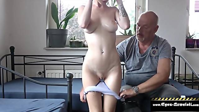 Stepfather gives massage to brunette