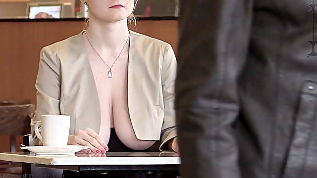 Beautiful blonde shows tits on public