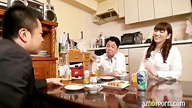 Beautiful Japanese wife drink with husband and his friend