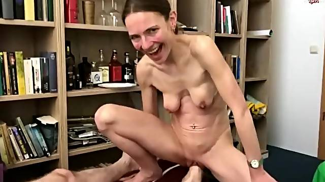 Skinny German woman with saggy tits gets foot fisted