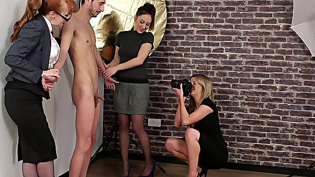 Photo-model gets his dick pleasured by three cock hungry CFNM models