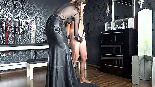 Mistress in leather jerking off big cock