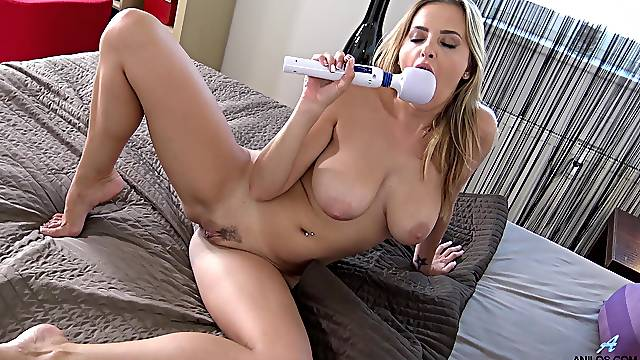 Video of naughty blonde Candy Alexa having some fun on the bed