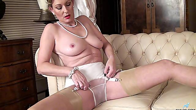 Gorgeous mature wife Mrs Huntingdon Smythe plays with her pussy