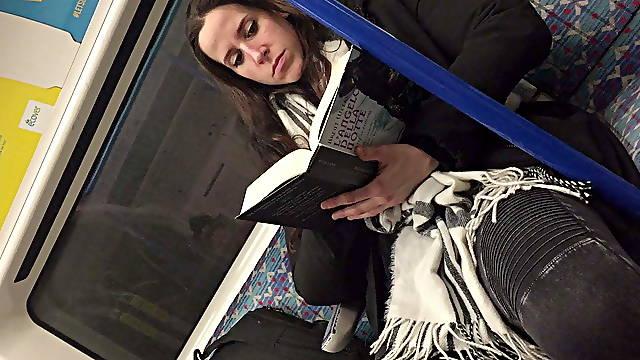 Girl read book in London metro