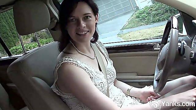 Pretty brunette masturbates in the car during driving