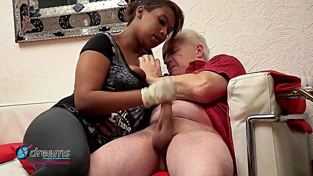 Ebony slut jerks off grandpa's cock with latex gloves