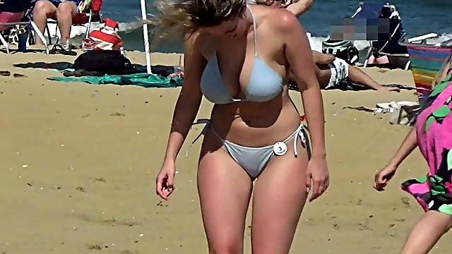 Booty beauty in bikini on the beach