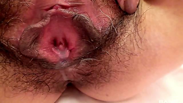 Hairy pussy Japanese mature Chiduru Tamiya enjoys pleasuring her cunt