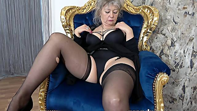Dirty granny in black lingerie and stockings moans while playing
