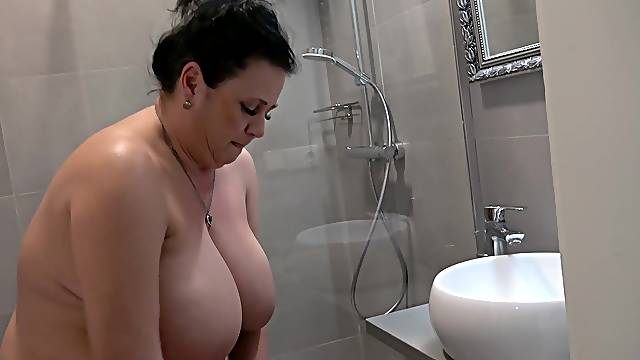 Hot brunette BBW loves teasing with her body while taking a shower