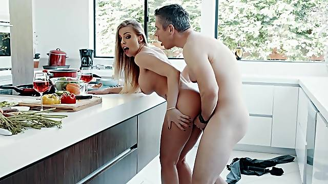 Busty Britney Amber enjoys the inches in the kitchen