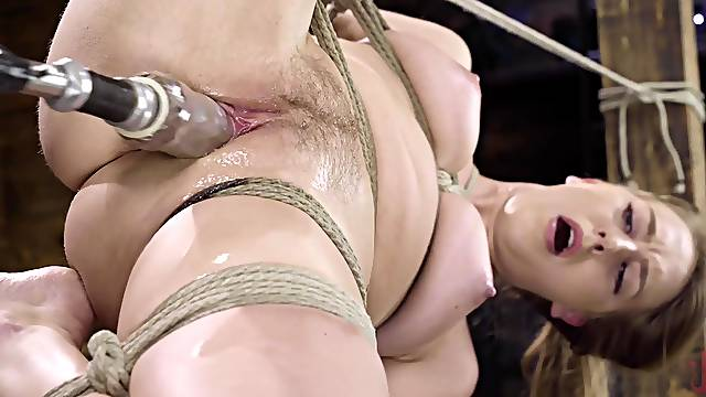 Solo girl uses the fucking machine in a rough BDSM play