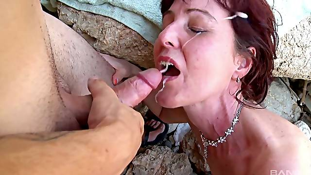 Nude mature fucked at the beach by a young hunk