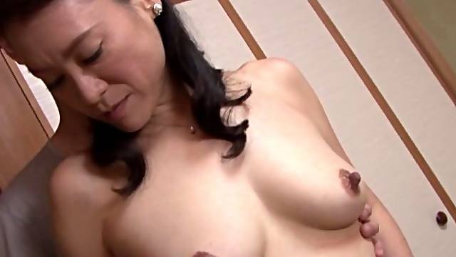 Naughty Japanese wife sucking cock and ball licking on her knees