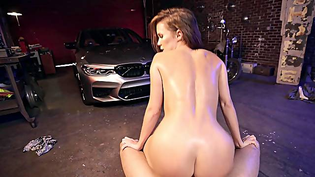 Hot milf rides guy's dick down at the garage