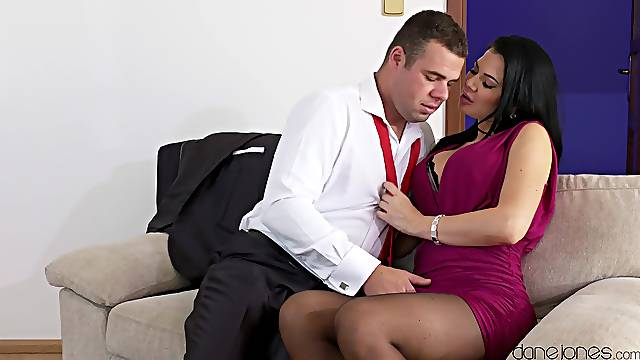 Chesty dark-haired MILF slates time for sexual delights