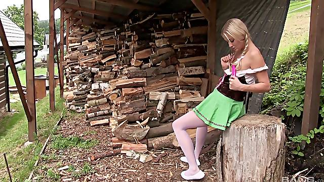 German slut toys her pussy in the back of the house