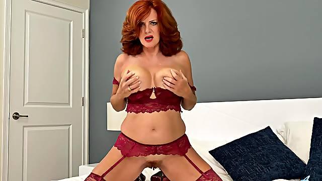 Wild mature redhead Andi James lustfully brings herself to orgasm