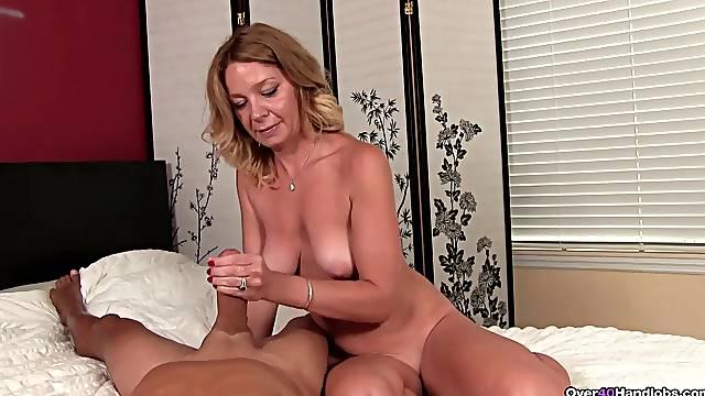 Nude mature mom in scenes of hard handjob with a big dick