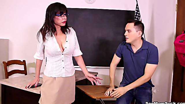 Appealing teacher seduces younger student in the classroom