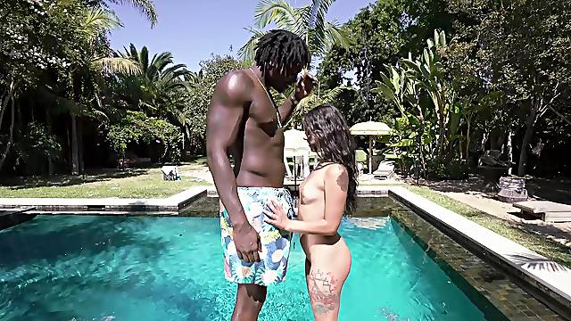 Gorgeous outdoor sex scenes by the pool between a petite girl and a black stud