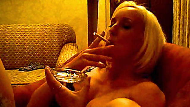 Blonde masturbates while smoking
