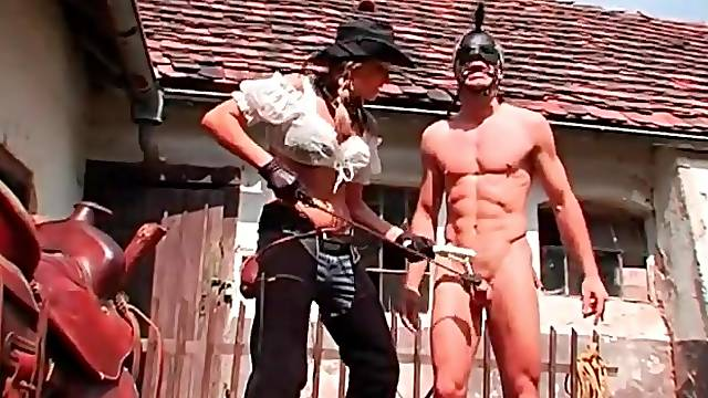 Rough abuse of guy during outdoor pony play session