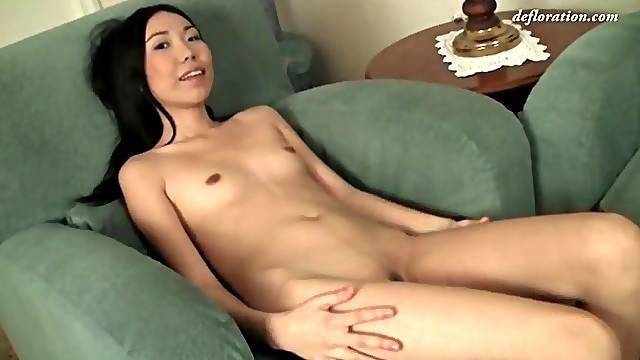 Skinny Asian in tight jeans striptease