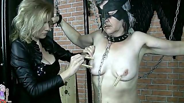 Submissive granny with clothes pins on tits