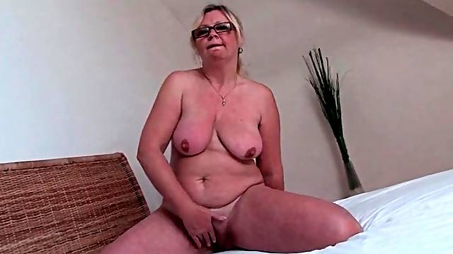 Mature blonde with hairy bush masturbates
