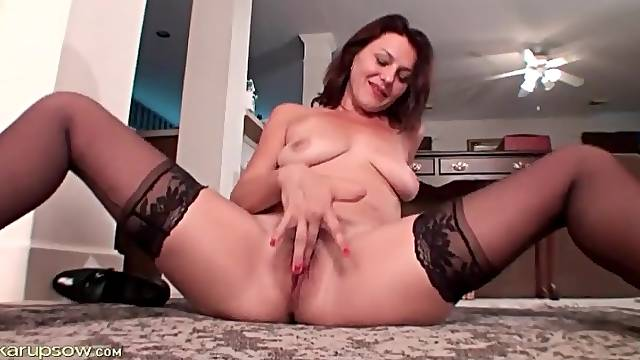 Mature teases hairy pussy close to camera