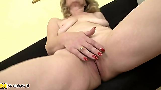 Stripping solo granny has nice saggy tits